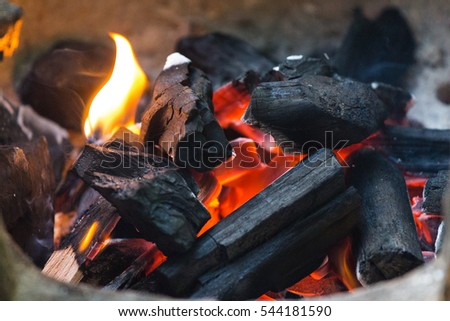 Burning charcoal in stove.
