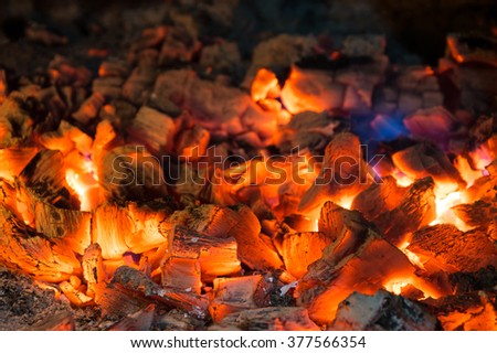 Burning charcoals in the background - stock photo