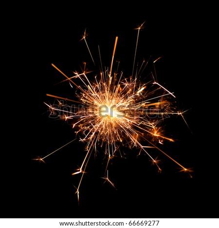 Burning christmas sparkler isolated on black background - stock photo