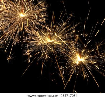 burning christmas sparklers isolated on black background  - stock photo