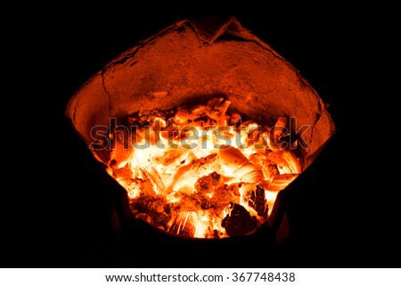 Burning coal. Burning flame. Fire burn. Hot fire background. Hot coal. Red fire burning. Embers coal. Heat coal. Fire coal. Hot power. Burning log. Burning wood. Camp fire. Burn frame. Dark fire frame - stock photo