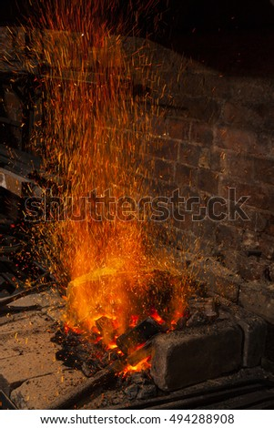 burning coals in the fireplace