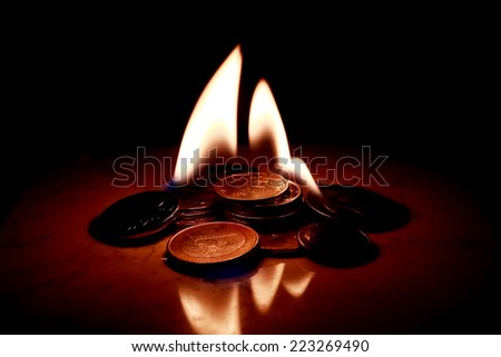 burning coins - stock photo