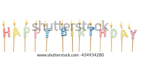 Burning colorful candles isolated on white background, words happy birthday