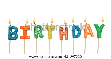 Burning colorful candles on white background, word birthday - stock photo