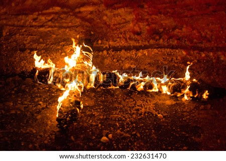 Burning cross on the chain, for religion concepts - stock photo