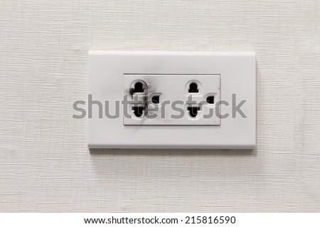 burning electric plug socket on the wall - stock photo