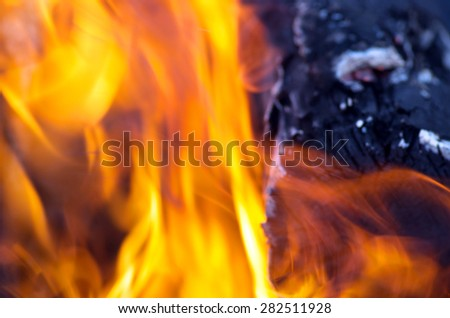 Burning fire close-up, may be used as background - stock photo