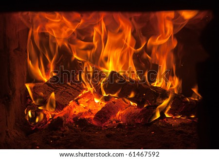 Burning fire wood in the brick furnace