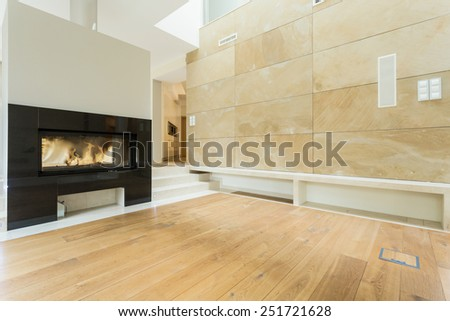 Burning fireplace in beige stylish house - stock photo