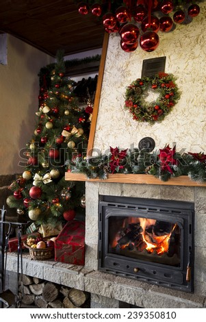 Burning Fireplace with christmas tree and decorations - stock photo