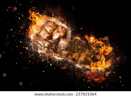 Burning fist of fire on black background. Concept image for fights, strikes or revolutions - stock photo
