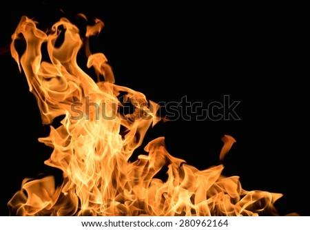 Burning flame on black background - stock photo