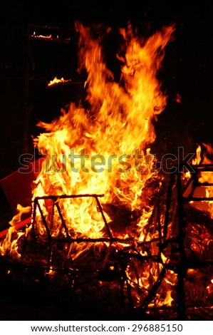 Burning furniture on a black background                                 - stock photo