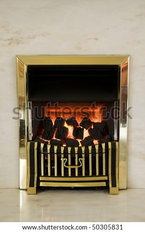 Burning gas fire and marble fireplace. - stock photo
