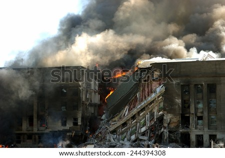 Burning gash in the outer face of the Pentagon shortly after terrorists crashed American Airlines Flight 77 into the building on Sept. 11 2001. - stock photo