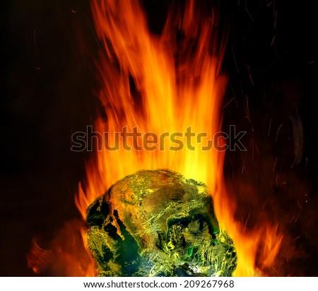 Burning  globe earth  (elements furnished by NASA) - stock photo