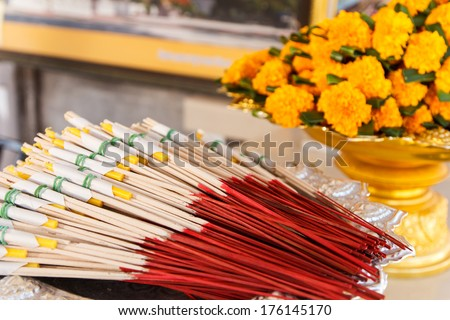 Burning incense sticks for pray and flower background - stock photo