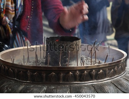 Burning incenses in a buddhist temple - stock photo