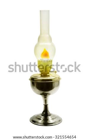 Burning kerosene lamp isolated on white - stock photo