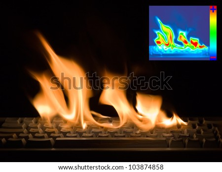 Burning Keyboard with Thermal Image Diagram for Damage Detection - stock photo