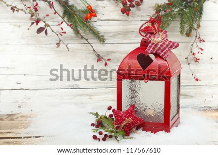 Burning lantern and christmas decoration - stock photo
