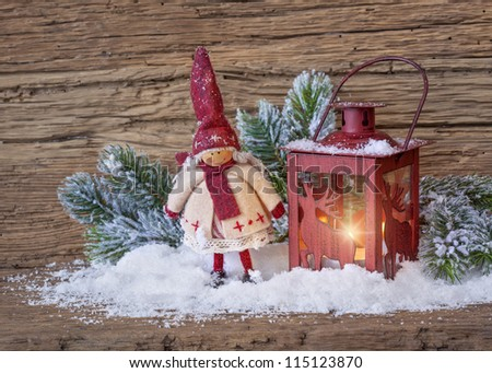 Burning lantern in the snow