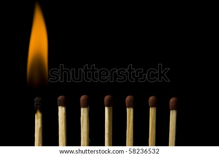 Burning match isolated in black - stock photo
