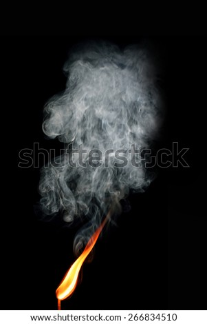 Burning matchstick with smoke - stock photo