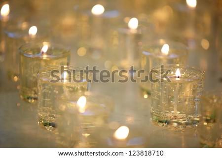 Burning memorial candles - stock photo