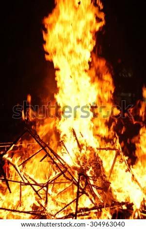 Burning on a black background - stock photo