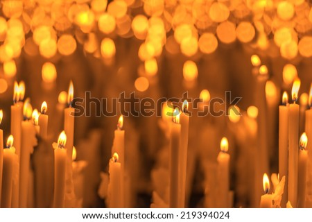 burning orange candles close up - stock photo