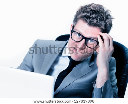 burning out of handsome manager at the office - stock photo