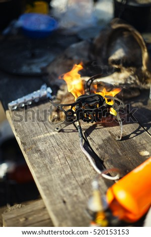 Burning portable gas burner at the base camp of climbers, close-up.