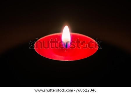Burning red aromatic candle.