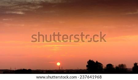 Burning Skies Sunset in the Sky  - stock photo