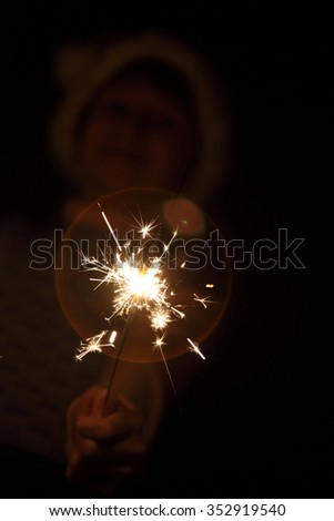 burning sparkler on a dark background