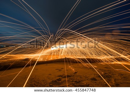 Burning steel wool on the beach