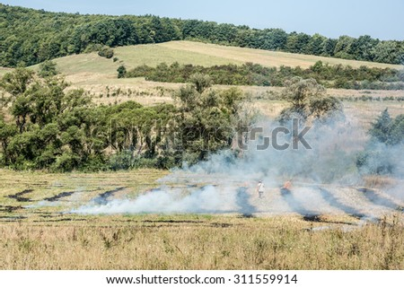 Burning straw stubble farmers may smoke pollution. Global warming. - stock photo