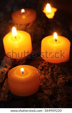 Burning tea candles close up, with selective focus