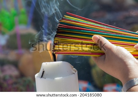 Burning the incense to worship the sacred - stock photo