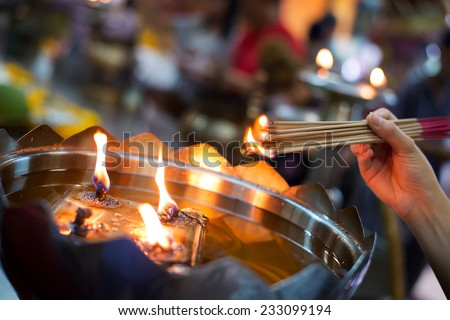 burning the joss stick - stock photo