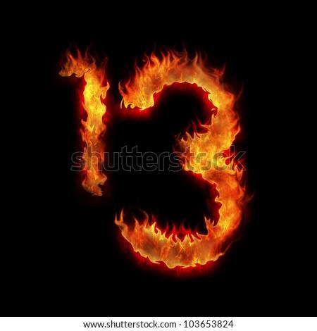 burning thirteen one three digits on black - stock photo