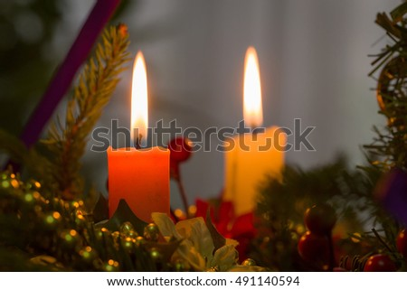 burning two candles on christmas tree