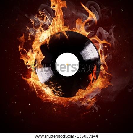 Burning vinyl disc-Hot hits - stock photo