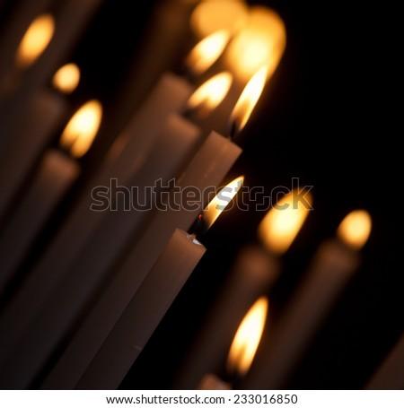 burning white candles close up - stock photo