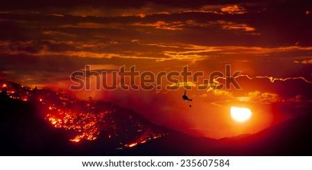 Burning Wildfire at Sunset - stock photo