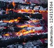 Burning wood and coal in fireplace. Closeup of hot burning wood, coals. - stock photo