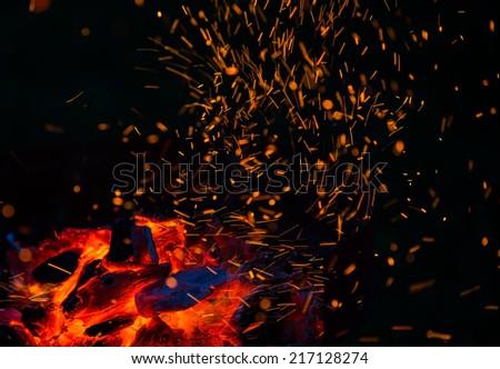 Burning wood and coal in fireplace. Closeup of hot burning wood, coals.  - stock photo