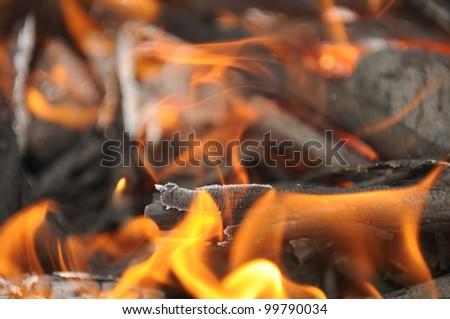 Burning Wood Embers with Flames - stock photo